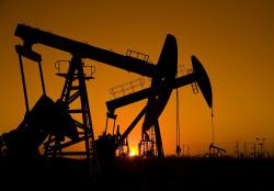 bigstock-Silhouette-of-oil-rigs-with-su-29395682.jpg